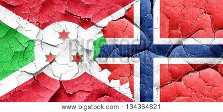 Burundi flag with Norway flag on a grunge cracked wall
