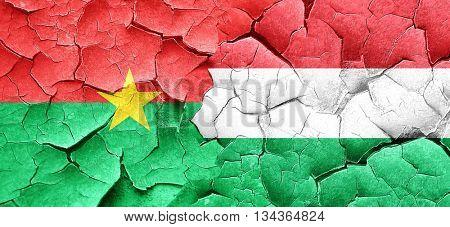 Burkina Faso flag with Hungary flag on a grunge cracked wall