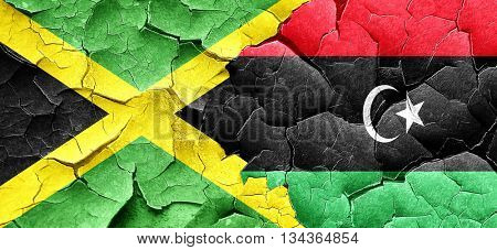 Jamaica flag with Libya flag on a grunge cracked wall