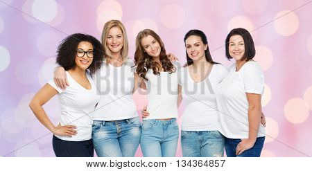 friendship, diverse, body positive and people concept - group of happy different size women in white t-shirts hugging over rose quartz and serenity lights background