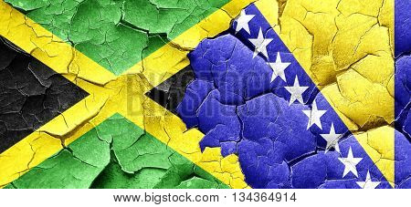 Jamaica flag with Bosnia and Herzegovina flag on a grunge cracke