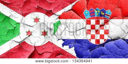 Burundi flag with Croatia flag on a grunge cracked wall