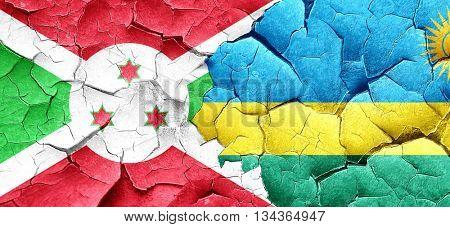 Burundi flag with rwanda flag on a grunge cracked wall