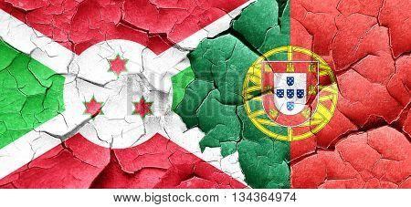 Burundi flag with Portugal flag on a grunge cracked wall