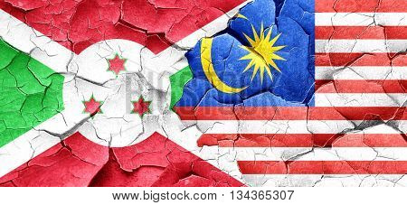 Burundi flag with Malaysia flag on a grunge cracked wall