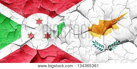 Burundi flag with Cyprus flag on a grunge cracked wall