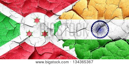 Burundi flag with India flag on a grunge cracked wall