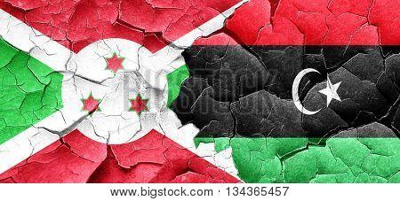 Burundi flag with Libya flag on a grunge cracked wall
