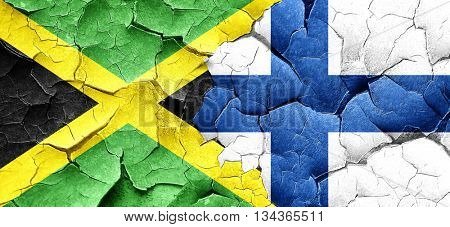 Jamaica flag with Finland flag on a grunge cracked wall