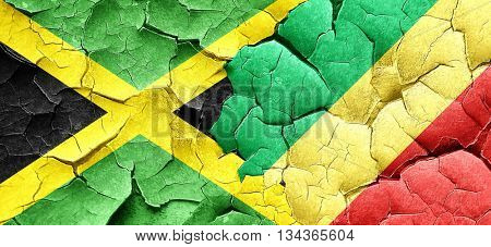 Jamaica flag with congo flag on a grunge cracked wall