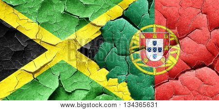 Jamaica flag with Portugal flag on a grunge cracked wall