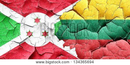 Burundi flag with Lithuania flag on a grunge cracked wall
