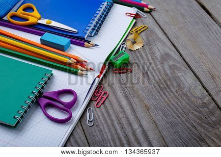 School supplies closeup on a wooden table with copy space
