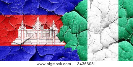 Cambodia flag with Nigeria flag on a grunge cracked wall