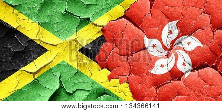 Jamaica flag with Hong Kong flag on a grunge cracked wall