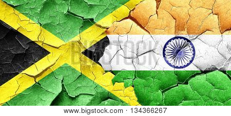 Jamaica flag with India flag on a grunge cracked wall