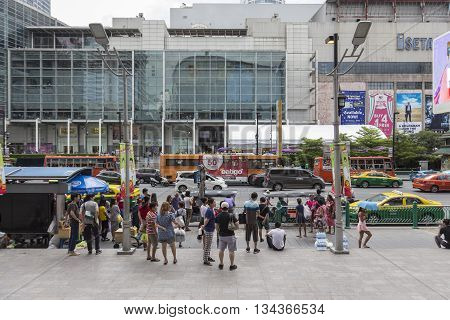 BANGKOK THAILAND - MAY 22 : people at bus stop in front of Big C Supercenter in Ratchaprasong area on may 22 2016 thailand. Ratchaprasong is one of is famous landmark of Bangkok