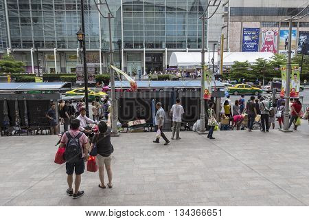 BANGKOK THAILAND - MAY 22 : group of people at bus stop in front of Big C Supercenter in Ratchaprasong area on may 22 2016 thailand. Ratchaprasong is one of is famous landmark of Bangkok