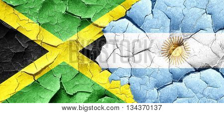 Jamaica flag with Argentine flag on a grunge cracked wall