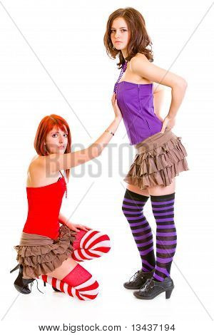 Cute girl on knees beging her girlfriend isolated on white