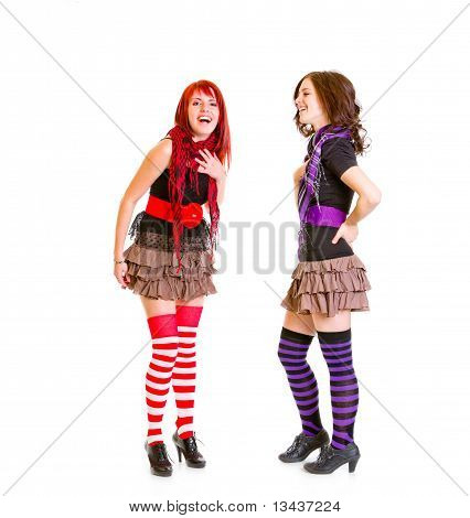 Two young girlfriends genuinely laughing isolated on white