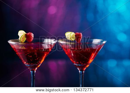 Close-up of two glasses with martini and fruits