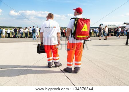 BERLIN / GERMANY - JUNE 3 2016: german paramedics from deutsches rotes kreuz stands on airport berlin germany at june 3 2016.