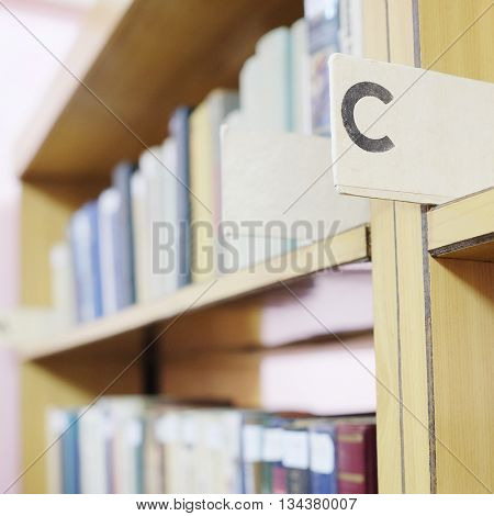 Books in a row. Bookshelf in public library.