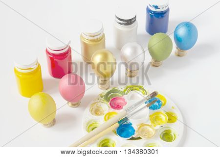 Brush On Paint Tray With  Colorful Eggs And Gold Coins
