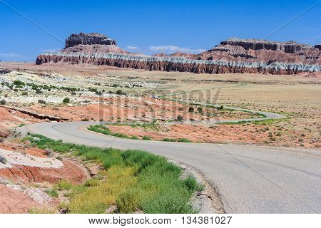Highway Running Through Colorful Painted Desert In Central Utah Near Canyonland, Zion, Bryce And Gob