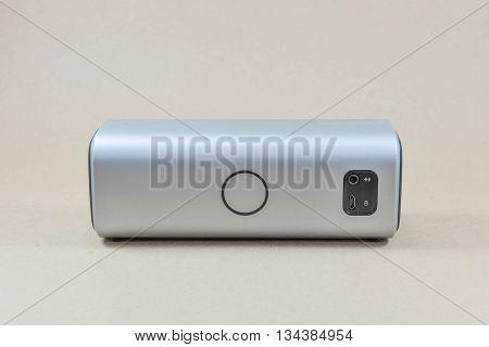 Wireless speaker bluetooth speaker on the brown screen