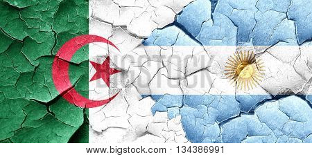 algeria flag with Argentine flag on a grunge cracked wall
