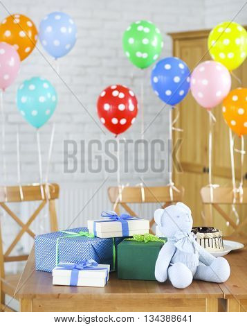 Baby shower. Sweets and presents on the table. Decorated with balloons