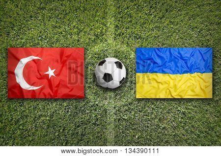 Turkey Vs. Ukraine Flags On Soccer Field