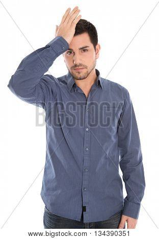Isolated man with blue shirt shocked and depressed.