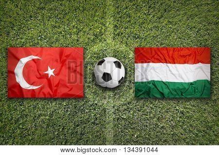 Turkey Vs. Hungary Flags On Soccer Field