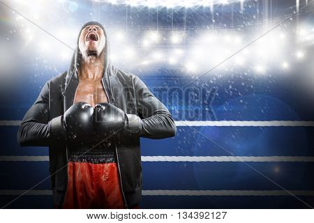 Boxer preparing for the tournament against composite image of ring ropes