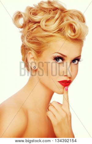 Vintage style portrait of young beautiful sexy blonde pin-up girl with thoughtful expression