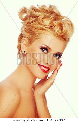 Vintage style portrait of young happy smiling blond girl with stylish make-up and hairdo