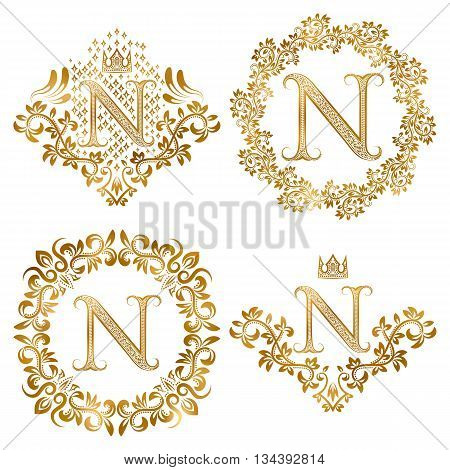 Golden letter N vintage monograms set. Heraldic monogram in coats of arms form letter N in floral round frame letter N in wreath heraldic monogram in floral decoration with crown.