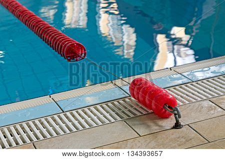 Background with a swimming pool and red markers between lanes competition.