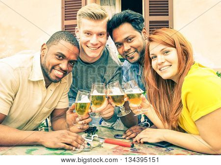 Multiracial friends beer cheers for school ending - Cheerful multiethnic teens holding drink glasses at street old city bar - Concept of fun and friendship in group of different races young people