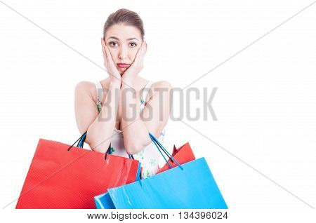 Woman Holding Shopping Bags And Feeling Worried Or Afraid