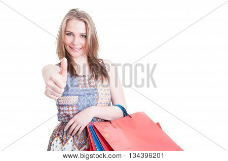 Portrait Of Attractive Smiling Girl With Shopping Bags Showing Thumbup