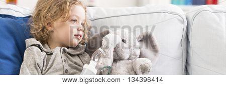 Little Boy With Inhaler