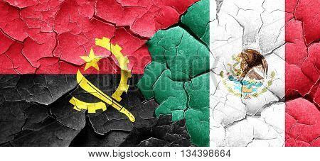 Angola flag with Mexico flag on a grunge cracked wall