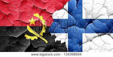 Angola flag with Finland flag on a grunge cracked wall
