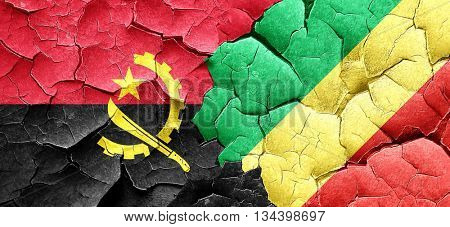 Angola flag with congo flag on a grunge cracked wall