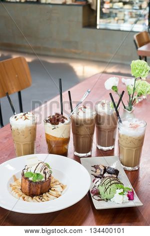 Variety iced coffee drinks on wooden table stock photo