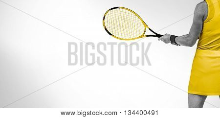 Athlete playing tennis with a racket against white background with vignette
